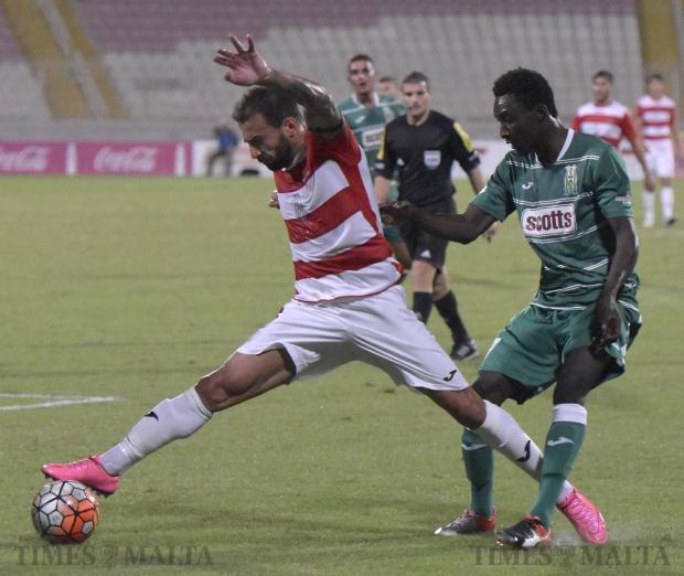 Valletta's Steve Borg stretches to control the ball as Floriana's Amadou Samb moves in during their Premier League football match at the National Stadium in Ta' Qali on September 21. Photo: Mark Zammit Cordina