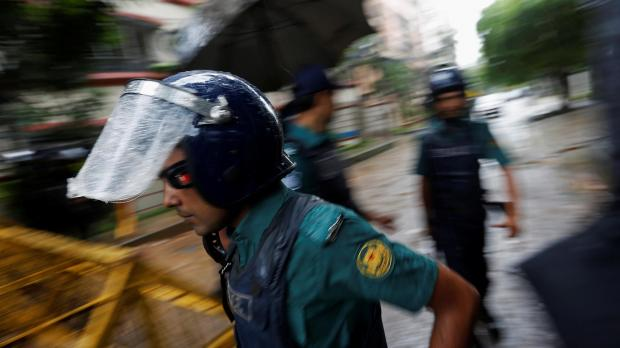 Police patrol Dhaka after the attacks. Photo: Reuters