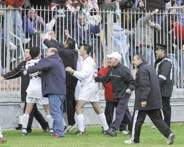 Happier times for J.J. Aquilina (right) as he rushes to celebrate with the players and club officials after a Valletta goal.