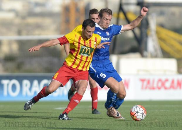 Birkirkara captain Gareth Sciberras (left) makes his way past Boris Pandža of Bosnia's NK Siroki Brijeg during their Europa League second leg match at the Hibernians Stadium in Corradino on July 5. Photo: Matthew Mirabelli