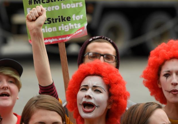 McDonald's workers stage company's first strike in Britain