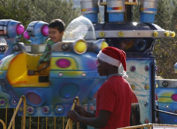 A child yelps with delight as he goes round on a carousel at the annual international Christmas fair at San Andrea School in Mgarr on December 11. Photo: Darrin Zammit Lupi