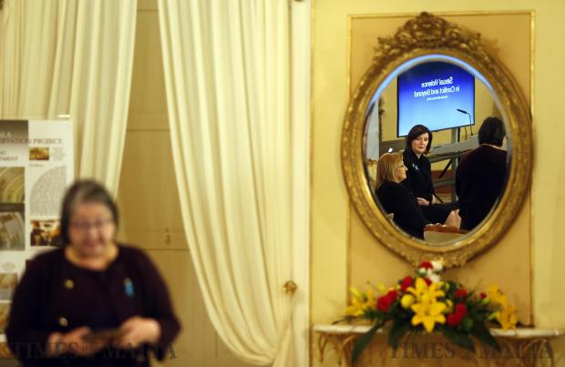 "President of Kosovo Atifete Jahjaga and Maltese President Marie-Louise Coleiro Preca are reflected in a mirror during the forum 'Sexual Violence in Conflict and Beyond"" at Verdala Palace on March 28. Photo: Darrin Zammit Lupi"