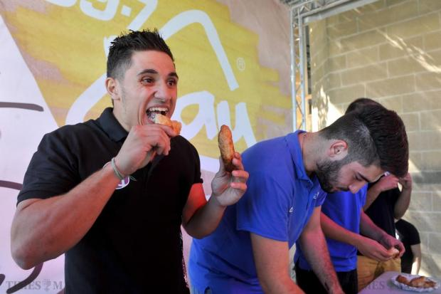 Students devour pastizzi as part of a pastizzi eating competition at the Freshers Week at the University of Malta on September 30. Photo: Chris Sant Fournier