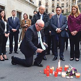 European Commissioner Frans Timmermans and Maltese MEPs take part in a vigil in Brussels yesterday in memory of Daphne Caruana Galizia. Photo: Reuters