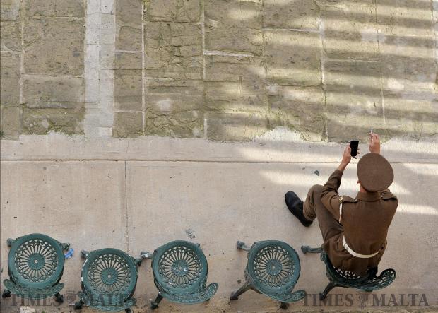 A soldier takes a break at the Upper Barrakka Gardens on November 30. Photo: Chris Sant Fournier