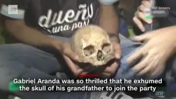 Football fan exhumes grandfather's skull to celebrate league title  | Video: CNN