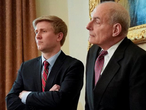 Vice President Pence's Chief of Staff Ayers and White House Chief of Staff Kelly look on as Trump holds a cabinet meeting at the White House in Washington.