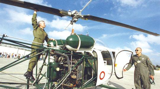 Colonel (now Brigadier) Carmel Vassallo (left) inspects the blades of an Agusta Bell helicopter in this file photo.