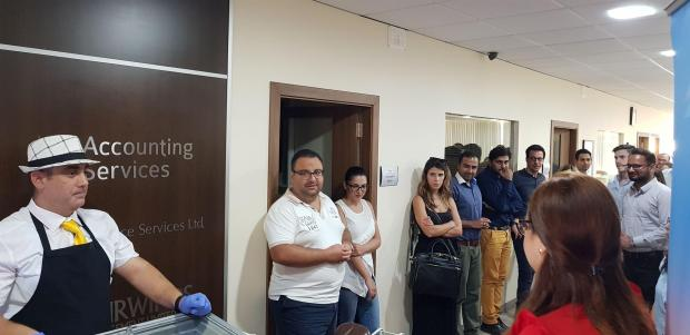 Group Chairman Adrian Sciberras addressing the employees during an ice-cream day held at the office to celebrate the fifth anniversary.