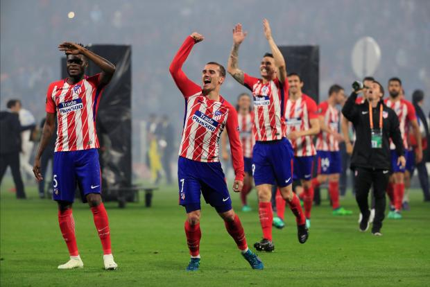 Atletico Madrid's Antoine Griezmann and team mates celebrate winning the Europa League.