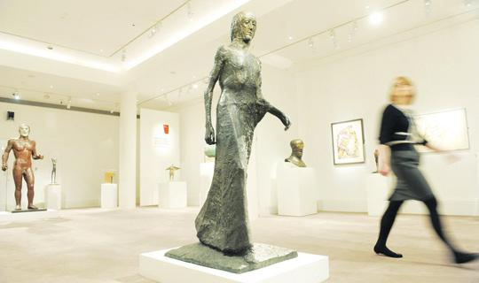 Walking Madonna, 1981 (centre) and Riace Figure III, 1986 (far left) by Elisabeth Frink are displayed at The Ingram Collection of 20th Century British Art at Sotheby's, London. Photo: Anthony Devlin/PA Wire