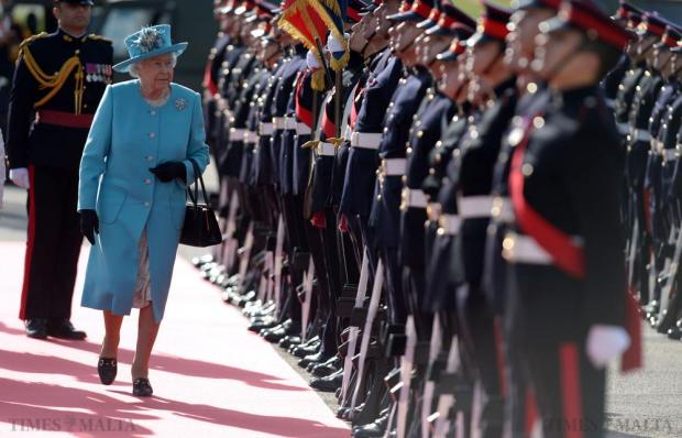 Queen Elizabeth inspects the guard of honour at Malta International Airport at the end of a three-day state visit on November 28. Photo: Matthew Mirabelli
