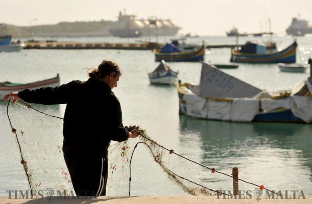 A fisherman sorts out fishing nets in Marsaxlokk on January 4. Photo: Chris Sant Fournier