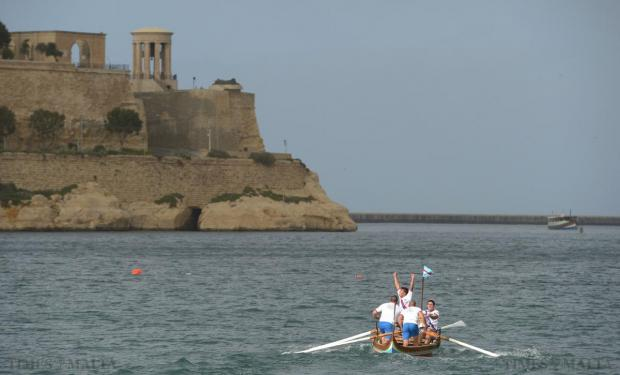 Birżebbuġa rowers celebrate after winning the tal-Midalji race at the Freedom Day Regatta in the Grand Harbour on March 31. Photo: Matthew Mirabelli