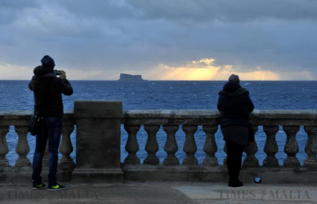A man takes a photograph of Filfla before dusk on January 7. Photo: Chris Sant Fournier