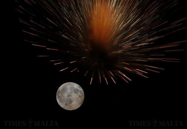 Fireworks explode in front of the full moon during celebrations for the feast of Saint Leonard, patron of the town of Kirkop on August 18. Photo: Darrin Zammit Lupi