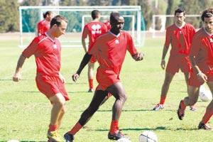 Orosco Anonam (centre) passing the ball during a training session at Ta` Qali yesterday.