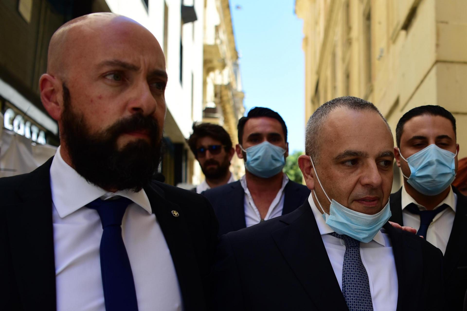 Neville Gafà accompanies Keith Schembri out of court last June. Photo: Mark Zammit Cordina