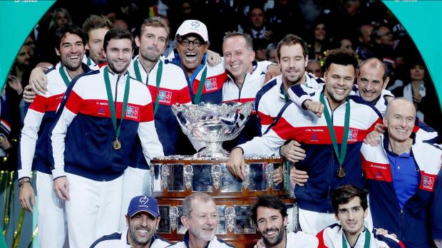 France players and officials celebrate their Davis Cup triumph over Belgium.