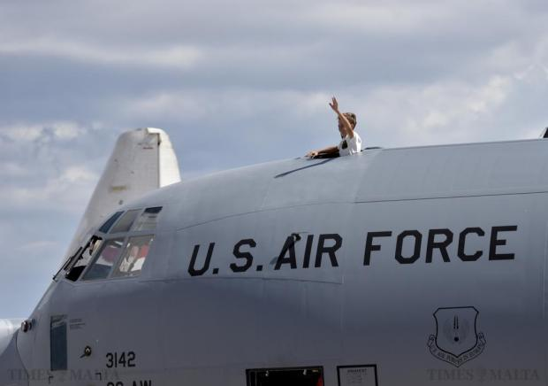A young boy waves to people from the top of a US Air Force plane at the Malta International Air Show on September 27. Photo: Mark Zammit Cordina