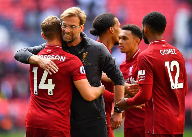 Liverpool manager Jurgen Klopp celebrates his team's win with the players at Wembley.