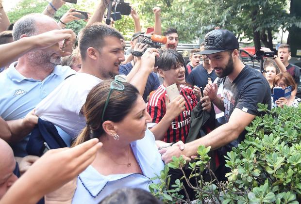 The newly-signed Rossoneri striker Gonzalo Higuain arrives for medical checks in Milan.