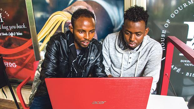 Muse Abdekadir, left, and Abdul Mohamed were able to purchase a laptop each thanks to Malta Microfinance. They are now are studying programming at Mcast.