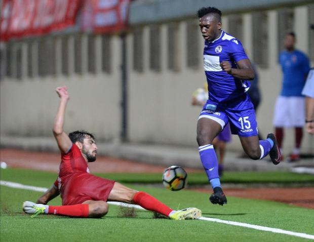 St Andrews striker Kevaun Atkinson fails to go past Michael Johnson, of Balzan during their BOV Premier League match at Centenary Stadium in Ta' Qali on August 25. Photo: Matthew Mirabelli