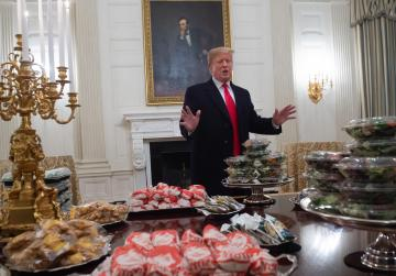 As shutdown bites, Trump foots bill for fast food feast for football team