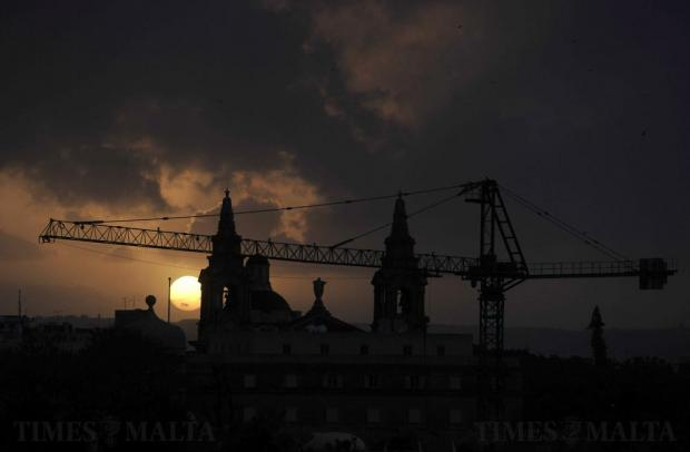 The sun sets behind St Publius church in Floriana on January 5. Photo: Chris Sant Fournier