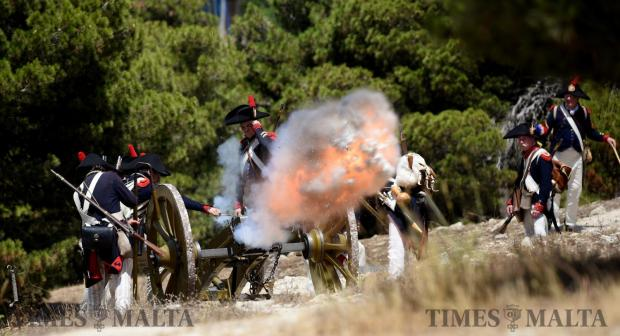 Re-enactors fire a cannon during a battle in San Maison on June 5. Photo: Mark Zammit Cordina