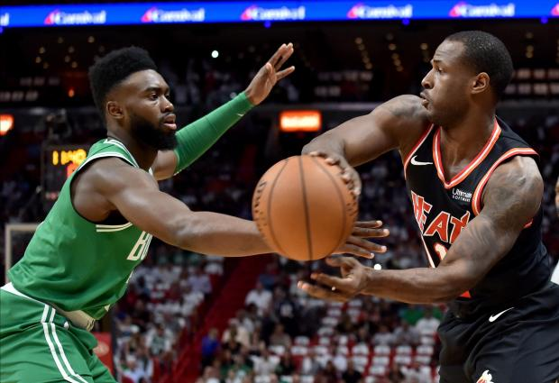 Boston Celtics' guard Jaylen Brown (7) applies the pressure against Miami Heat guard Dion Waiters.