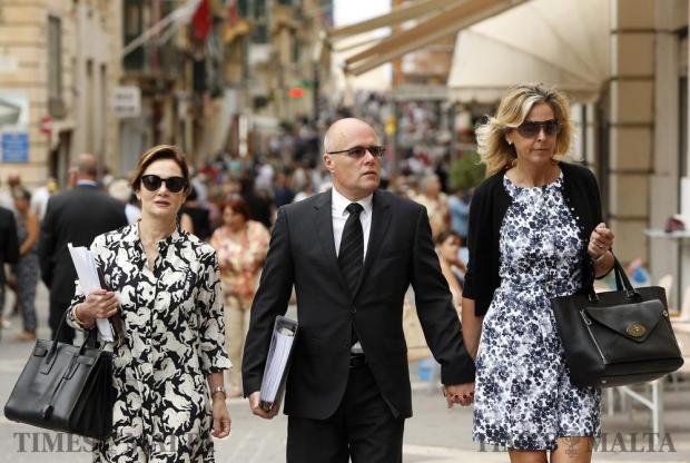 British millionaire Paul Bailey (centre), accompanied by his wife Selena (right) and defence lawyer Giannella de Marco (left), arrives at the court to face charges in connection with his dramatic supercar crash at the Paqpaqli Ghall-Istrina charity motor show in October 2015 which left 23 people injured, in Valletta on June 13. Photo: Darrin Zammit Lupi