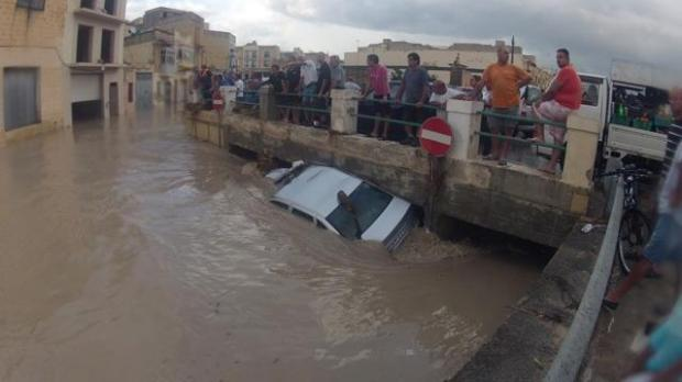A car blocks water flow under a bridge in Qormi. Picture - Stephen Zammit Lupi. mynews@timesofmalta.com