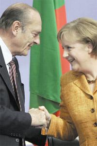 French President Jacques Chirac congratulates German Chancellor Angela Merkel following her speech at a summit at the German Historical Museum in Berlin on Sunday.