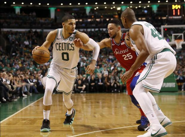 Philadelphia 76ers guard Ben Simmons (25) controls the ball against Boston Celtics forward Al Horford (42) and forward Jayson Tatum (0) during the second half of Boston's 117-101 win in game one of the second round of the 2018 NBA Playoffs at TD Garden. Photo Credit: Winslow Townson-USA TODAY Sports
