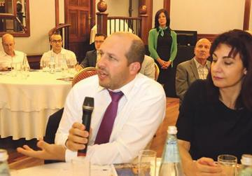 Bank of Valletta EU & Institutional Affairs executive Mark Scicluna Bartoli asking a question to Estelle Goger (top).