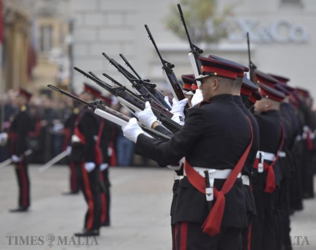 Members of the Armed Forces of Malta prepare to fire their rifles during the annual Republic Day parade ceremony in Valletta on December 13. Photo: Mark Zammit Cordina