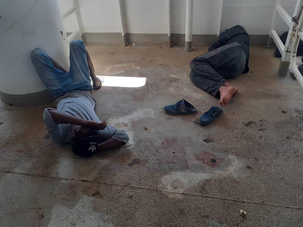 Migrants trying to get some rest on the dirty floor