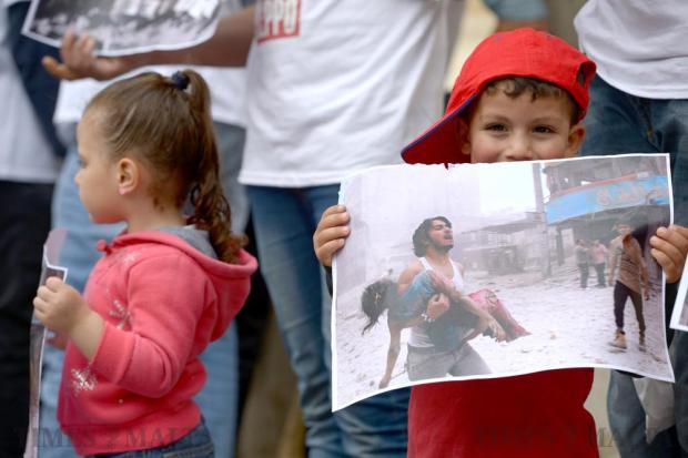 Syrian children at a silent protest in Valletta on May 6 reminded commuters of the children in the war-torn city of Aleppo who have been injured or killed by the constant bombing and fighting. Photo: Matthew Mirabelli