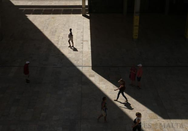 Pedestrians walk near Parliament House in Valletta on August 1. Photo: Darrin Zammit Lupi