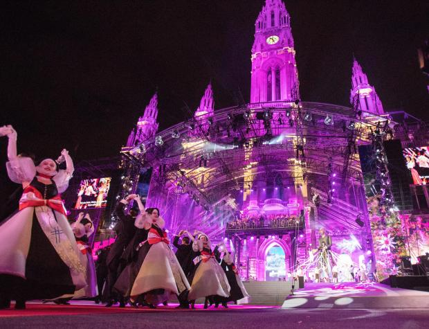 In this file photo taken in 2018, artists perform during the opening ceremony of the Life Ball in front of Vienna City Hall.