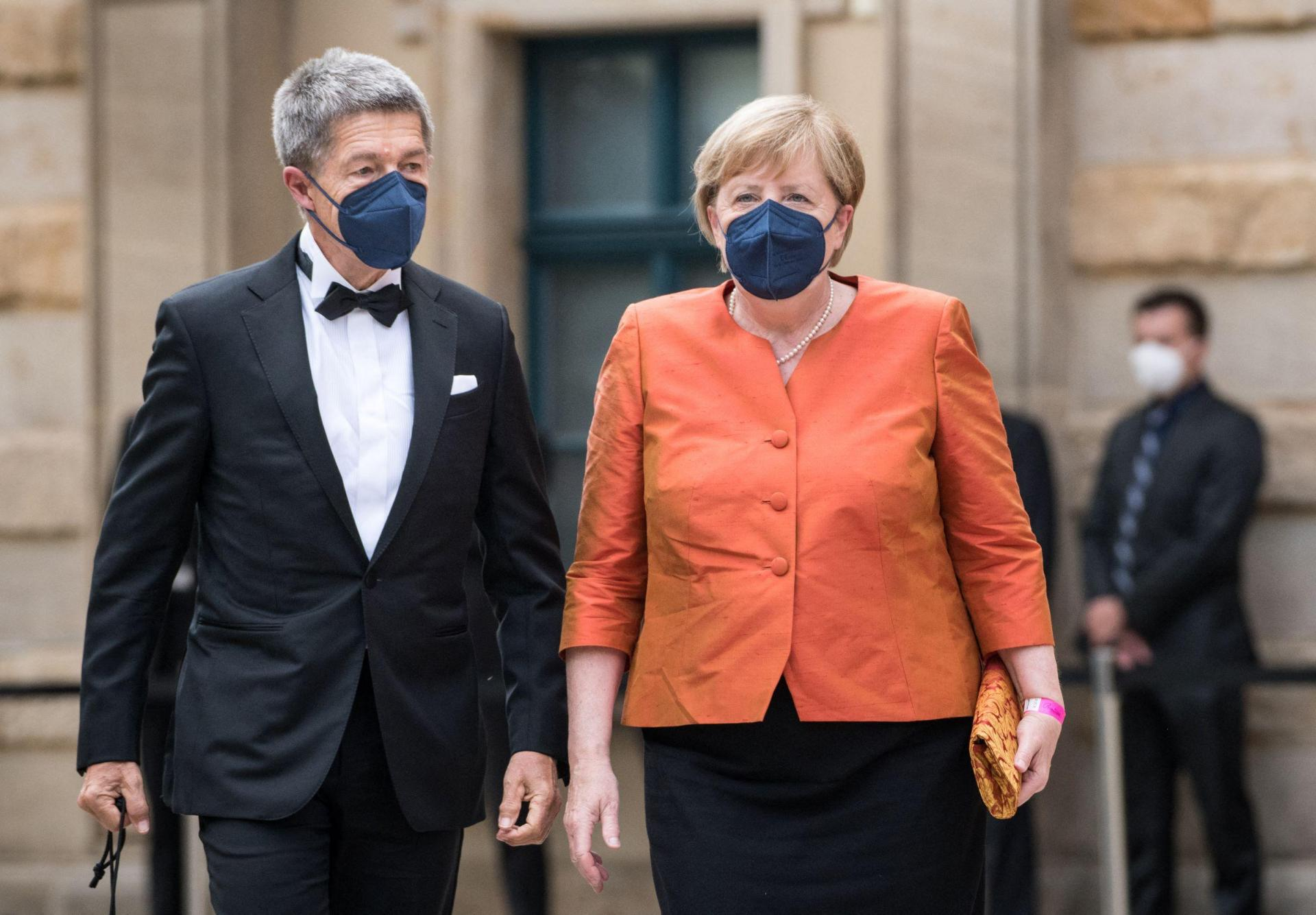 German Chancellor Angela Merkel and her husband Joachim Sauer arrive for the opening ceremony of the annual Bayreuth Festival. Photo: Stefanie Loos/AFP