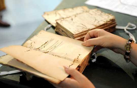 The National Library has hundreds of old, priceless books that are falling to pieces because of lack of resources. Some help is on the way through the likes of a campaign by Air Malta and the Sliema Lions Club. Photo: Matthew Mirabelli
