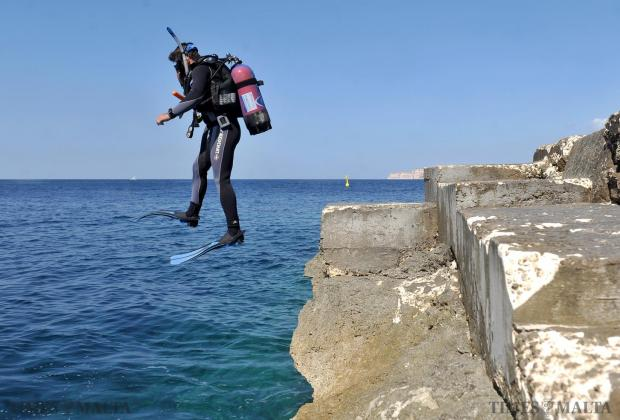 A diver jumps into the sea before a dive at Cirkewwa on September 12. Photo: Chris Sant Fournier