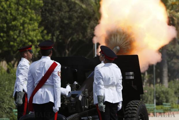 Armed Forces of Malta artillery soldiers fire a gun salute during a ceremony marking the 52nd anniversary of Malta's independence, in Floriana on September 21. Photo: Darrin Zammit Lupi