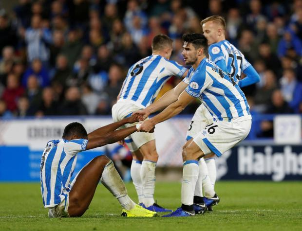 Huddersfield Town's Terence Kongolo looks dejected with Christopher Schindler after the match