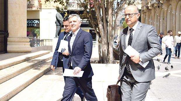From left: MEP David Casa and MPs Simon Busuttil and Jason Azzopardi walking into the law courts in Valletta.