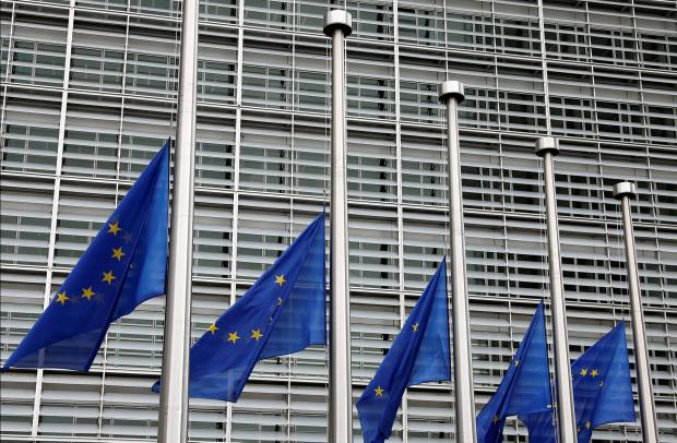 EU flags fly at half mast in Brussels following the Barcelona attacks. Photo: Reuters